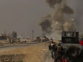 The aftermath of an Islamic State suicide attack on an Iraqi column