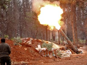 Rebels fire a mortar into west Aleppo from a home-made launcher