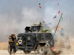 Iraqi forces fire rockets during the fight for Bartella