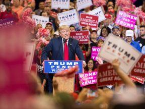 Donald Trump addresses a rally in Arizona