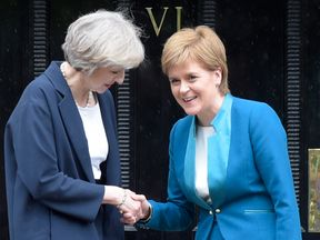 Nicola Sturgeon (R) has already made clear she wants to Theresa May (L) to include Scotland in Brexit discussions