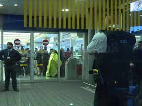 Passengers and security at London City Airport following the evacuation
