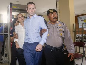 David Taylor and Australian woman Sara Connor are escorted by police