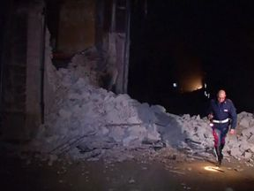 A collapsed building in Visso - the epicentre of the two quakes