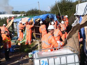 Workers begin the demolition of the Calais 'Jungle' camp