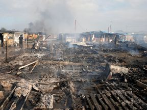 The charred debris from shelters and tents after fires raged in the 'Jungle'