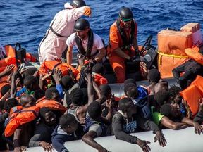 MSF members distribute life jackets during the rescue in the Mediterranean