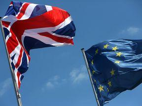 The Union Jack and EU flags.
