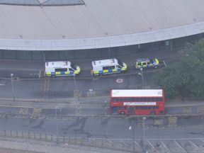Aerial shot of police outside North Greenwich Tube station on Oct 20, 2016. Station is closed and a controlled explosion has been carried out following discovery of suspicious item.