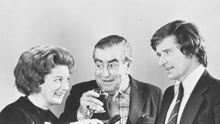 Alexander appears in a publicity shot with her on-screen husband Stan Ogden (Bernard Youens) and Coronation Street co-star Bill Roache, who plays Ken Barlow in the soap