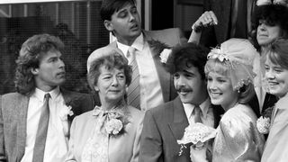 Hilda Ogden attends the wedding of Kevin Webster (Michael Le Vell) and Sally Seddon (Sally Dynevor) in 1986