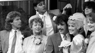 Hilda Ogden attends the wedding of Kevin Webster (Michael Le Vell) and Sally Seddon (Sally Dynevor) in 1986