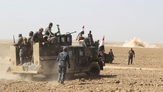 Iraqi forces deploy in the Bajwaniyah village