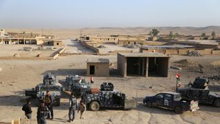 Iraqi security forces gather in Qayara, south of Mosul, to attack Islamic State militants