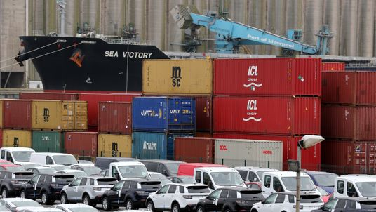 Shipping containers and vehicles wait to be loaded for export at Liverpool Docks