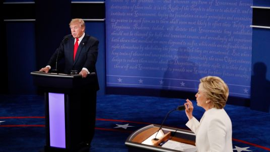 Hillary Clinton speaks as Donald Trump looks on during the third US presidential debate in Las Vegas.