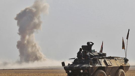Iraqi forces battle against Islamic State (IS) group jihadists in the Bajwaniyah village