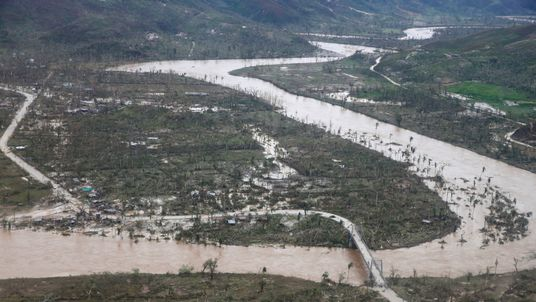 A flooded river and destroyed houses in Jeremie
