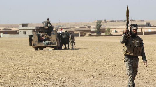 Iraqi forces deploy in the Bajwaniyah village, about 30 kms south of Mosul after they liberated it from Islamic State