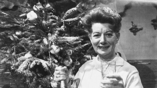 Jean Alexander enjoys a seasonal drink as she prepares to film her last Coronation Street episode in 1987