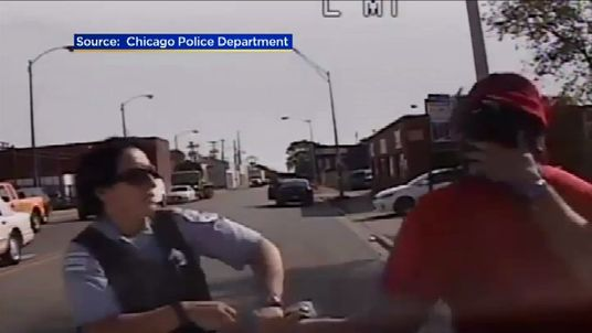 A female Chicago police officer tries to restrain a suspect