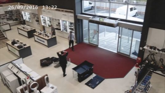 The shopper was clearly stunned by what had happened. Pic: YouTube/HBHWoolacotts