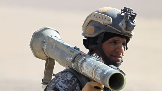 An Iraqi forces member holds a rocket propelled grenade launcher in the Bajwaniyah village