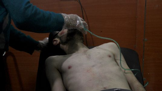 A man being treated after an alleged poison gas attack in Syria in 2014