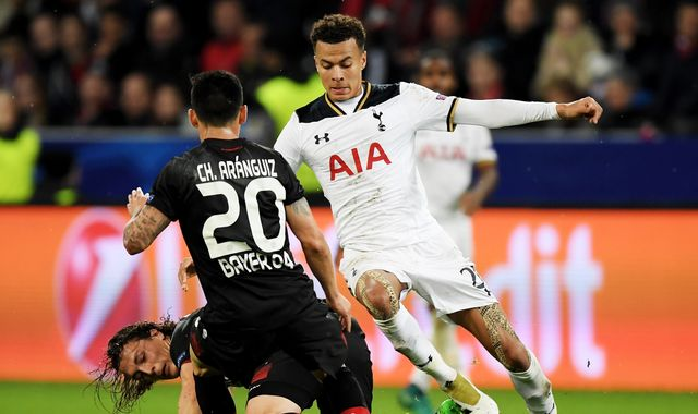 Spurs hold on to secure valuable point