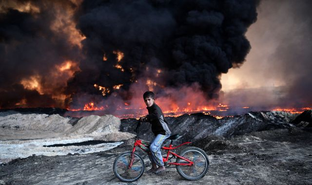 Toxic smoke hampers offensive to retake IS stronghold of Mosul
