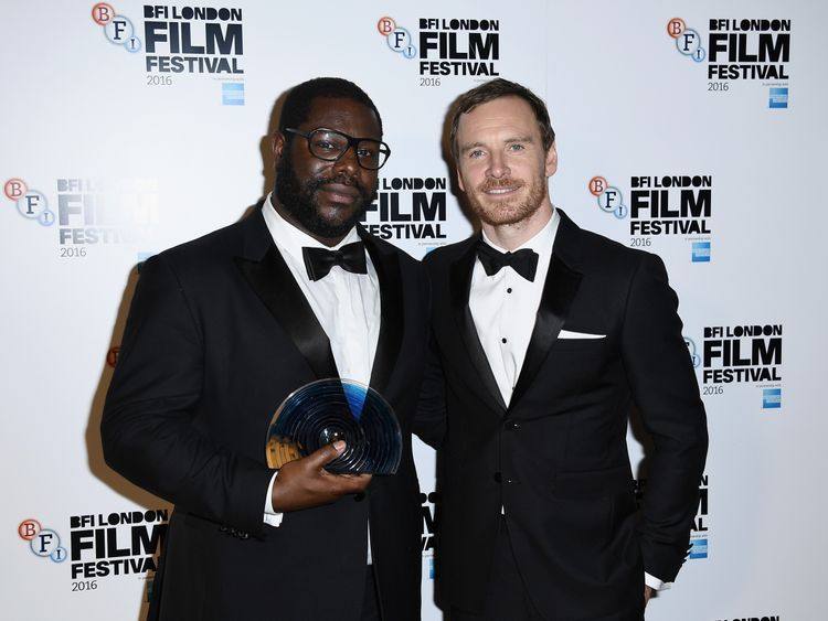 Director Steve McQueen (L) received the BFI Fellowship award from Michael Fassbender at the London Film Festival awards