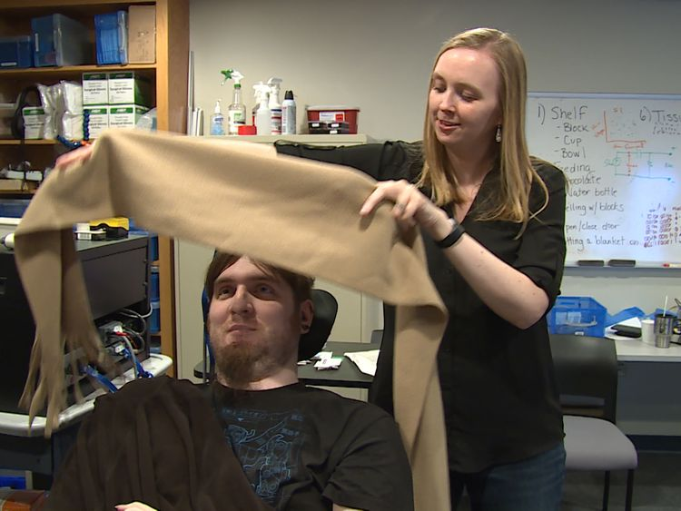 Paralysed Nathan Copeland experiences touch in his fingers thanks to robotic arm.