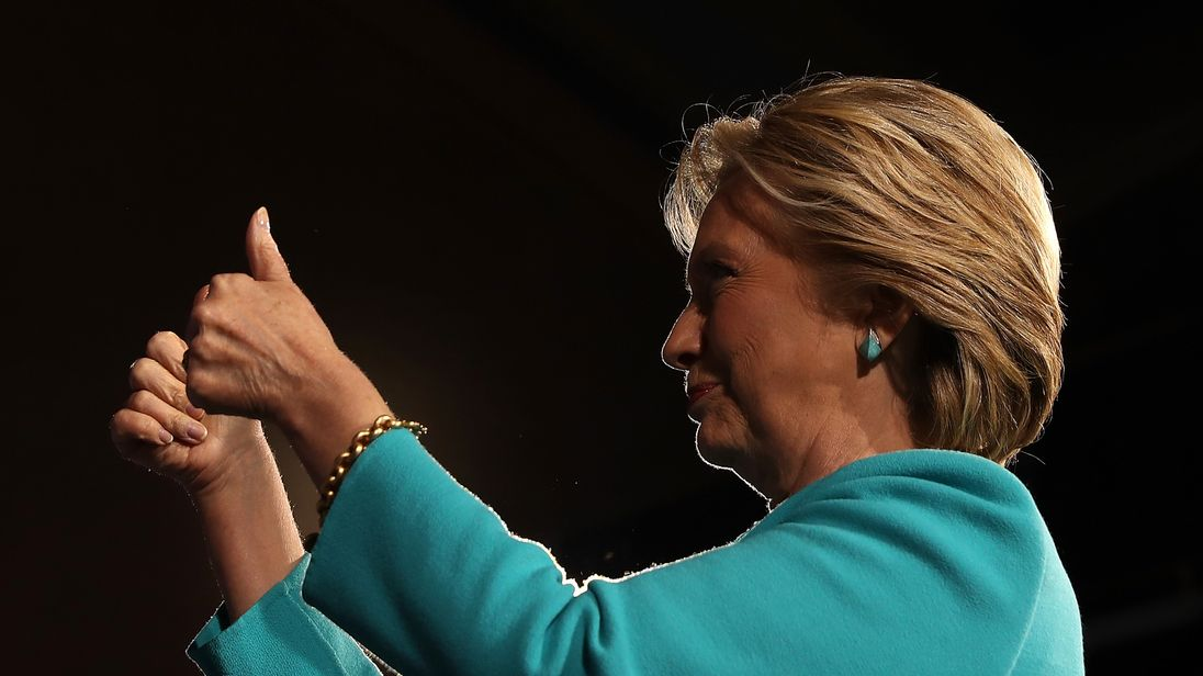 Democratic presidential nominee former Secretary of State Hillary Clinton greets supporters during a campaign rally at the Cleveland Public Auditorium on November 6, 2016 in Cleveland, Ohio