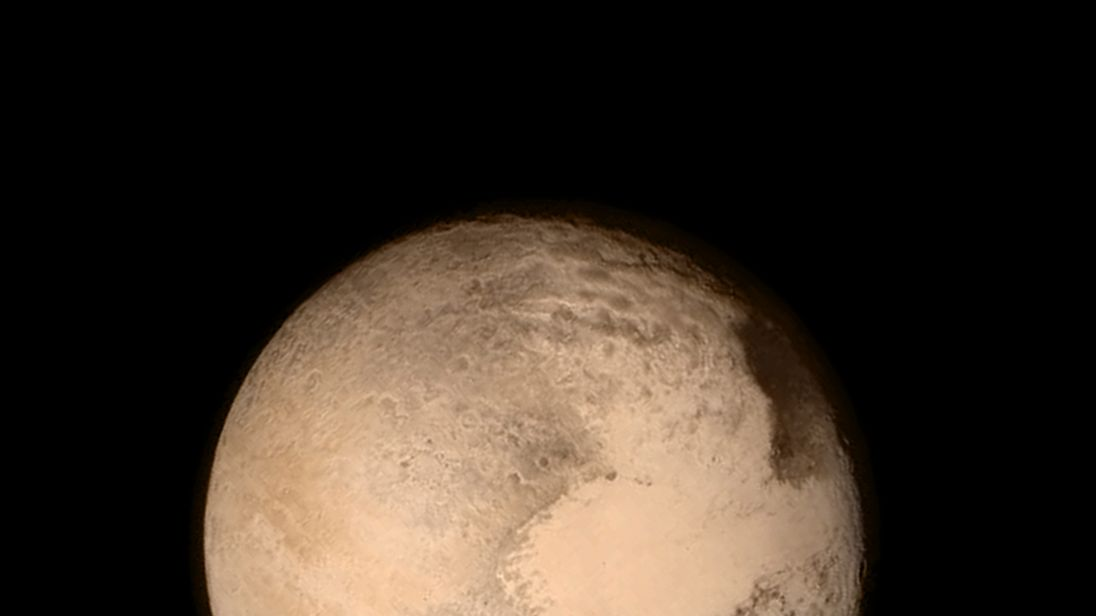 Pluto nearly fills the frame in this image from the Long Range Reconnaissance Imager (LORRI) aboard NASA?s New Horizons spacecraft, taken on July 13, 2015 when the spacecraft was 476,000 miles (768,000 kilometers) from the surface.