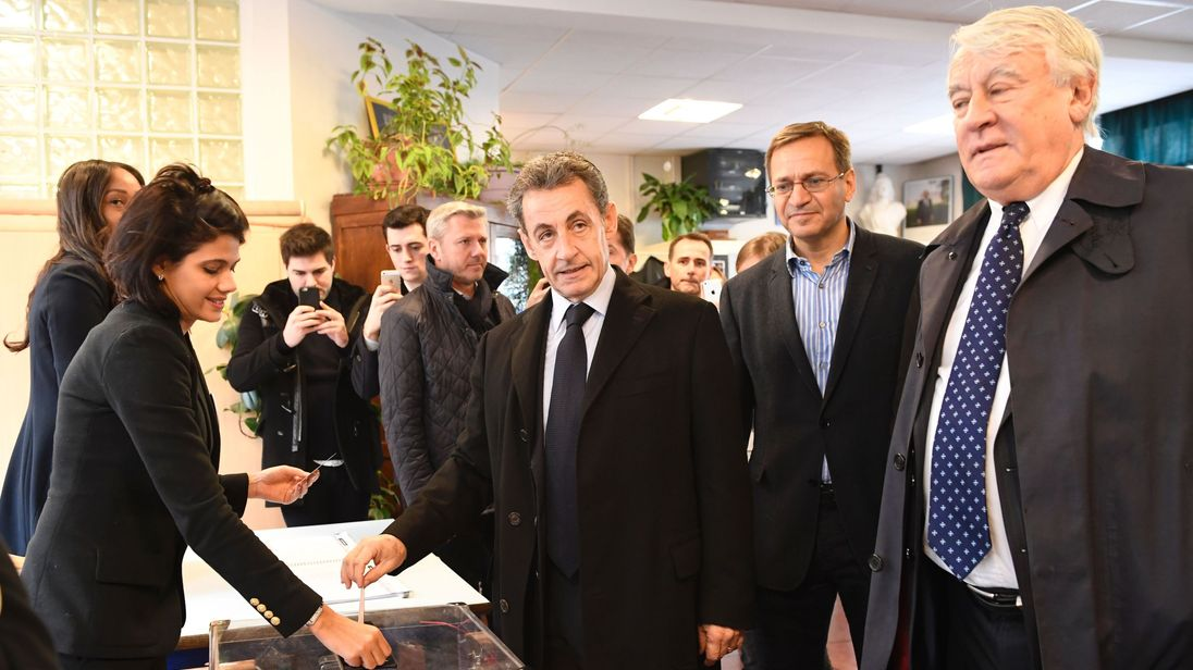 Former French president Nicolas Sarkozy casts his vote in Paris