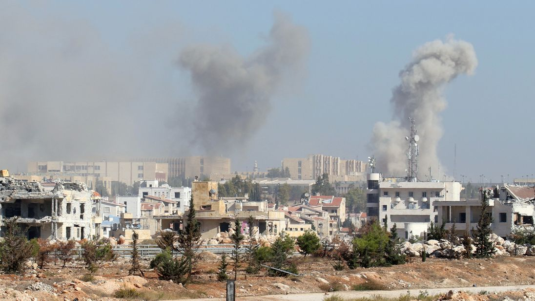 Smoke rises from government-controlled New Aleppo neighbourhood, western Aleppo city, Syria