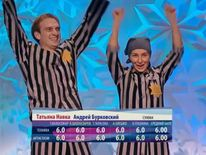 Tatiana Navka and Andrey Burkovsky celebrate scoring sixes all round