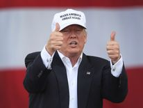 Donald Trump flashes two thumbs up during a campaign rally in Miami