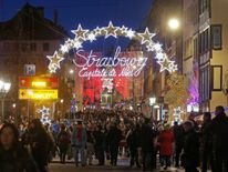 Tourists visit the traditional Christkindelsmaerik (Christ Child market) near Strasbourg's Cathedral