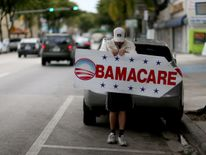 Man with Obamacare sign