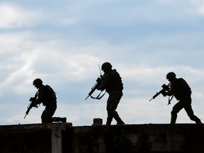 Soldiers take part in a field exercise in Kosovo