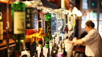 Spirit bottles lined up behind the bar in a pub on March 11, 2011 in London, England