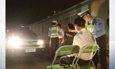 China's police practices 'full-beam' punishment for drivers