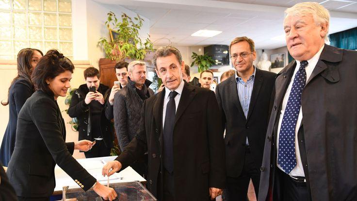 Former French president Nicolas Sarkozy casts his vote in Paris