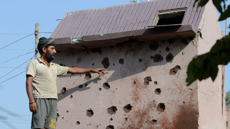 An Indian resident points out damage to property from cross border firing in Gajansoo border village