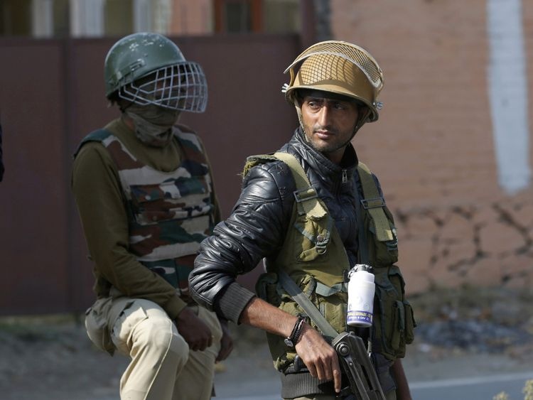 Indian policemen stand guard in Srinigar, Kashmir
