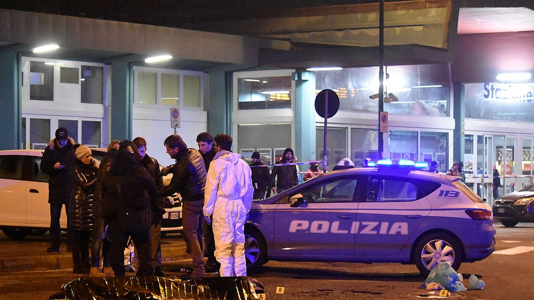 Italian police and forensics experts gather around the body of suspected Berlin truck attacker Anis Amri in Milan