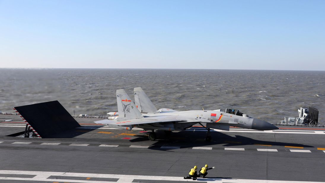 A Chinese J-15 fighter jet preparing to take off during military drills in the Bohai Sea