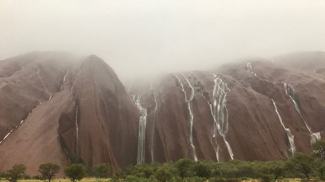 Stunning waterfalls on Uluru. Pic: Parks Australia