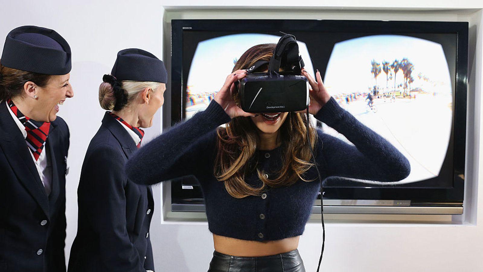 Nicole Scherzinger tries on an Oculus Rift headset